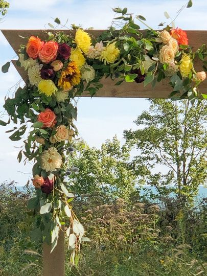 wedding arch outside trellis